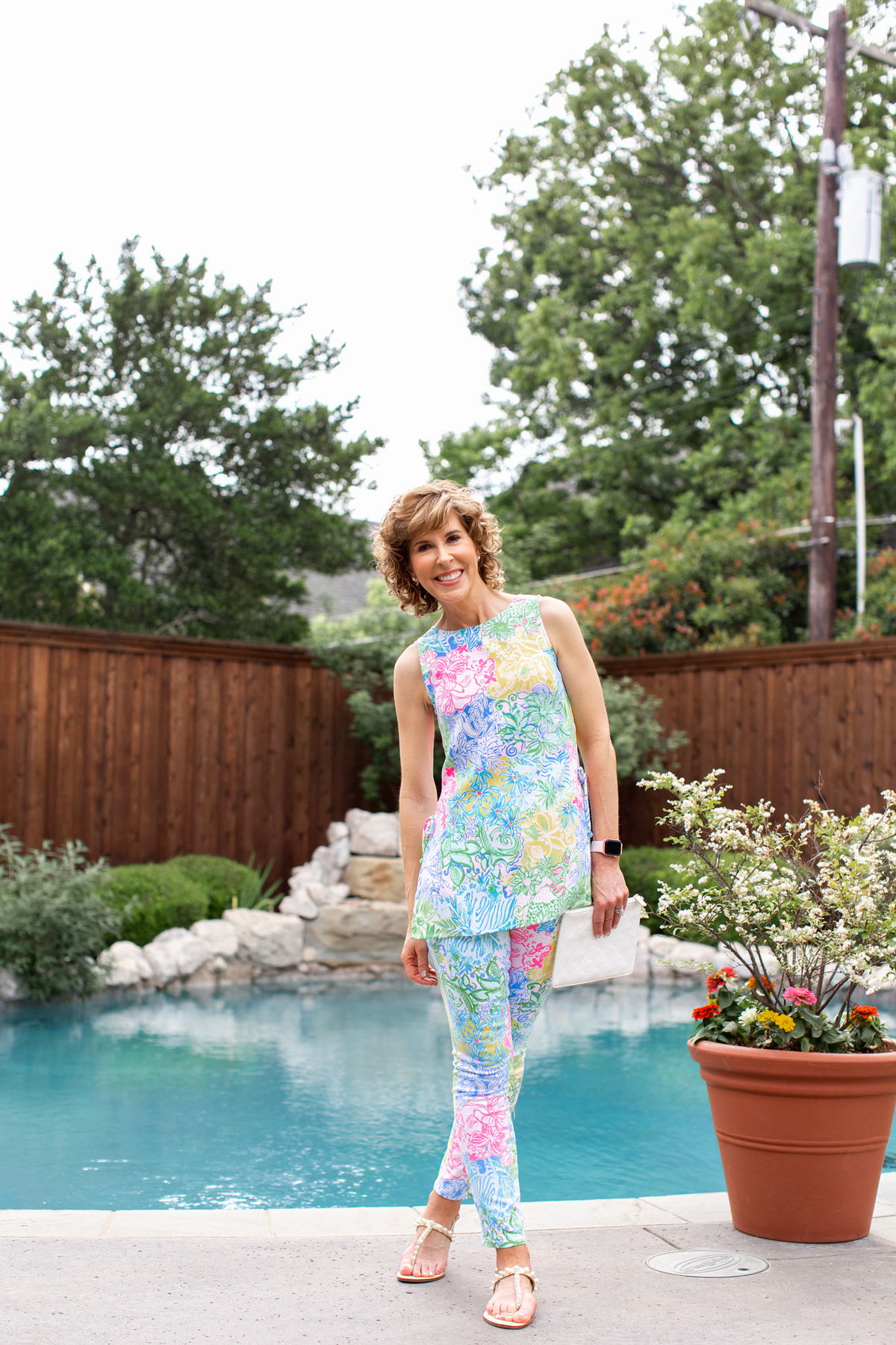 woman standing in front of a pool wearing lilly pulitzer outfit