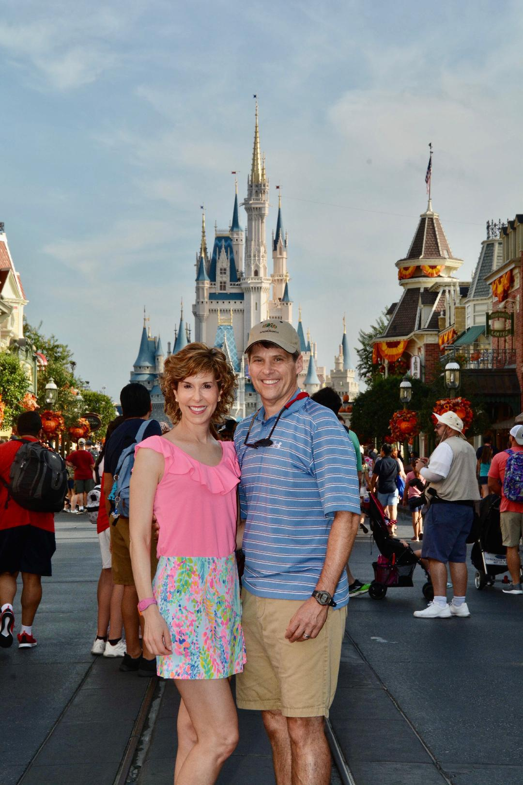 couple in front of cinderella's castle at walt disney world