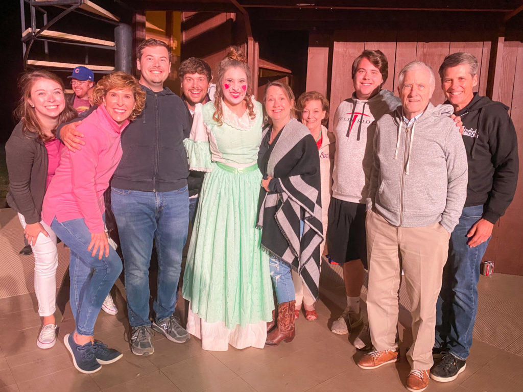 group of people gathered around the wardrobe from beauty and the beast at starlight mountain theatre in garden valley idaho
