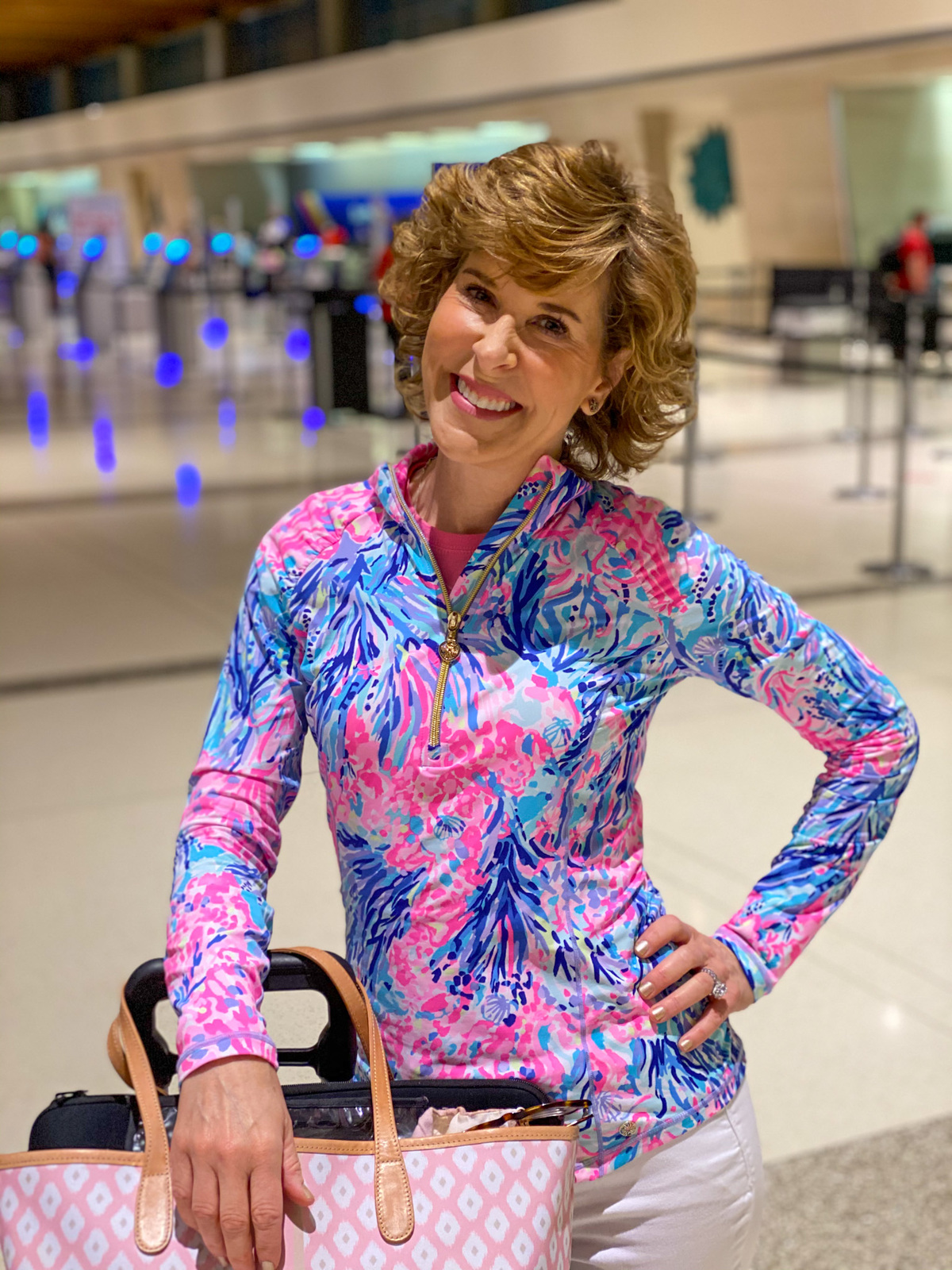 woman wearing lilly pulitzer luxletic pullover in dallas love field airport