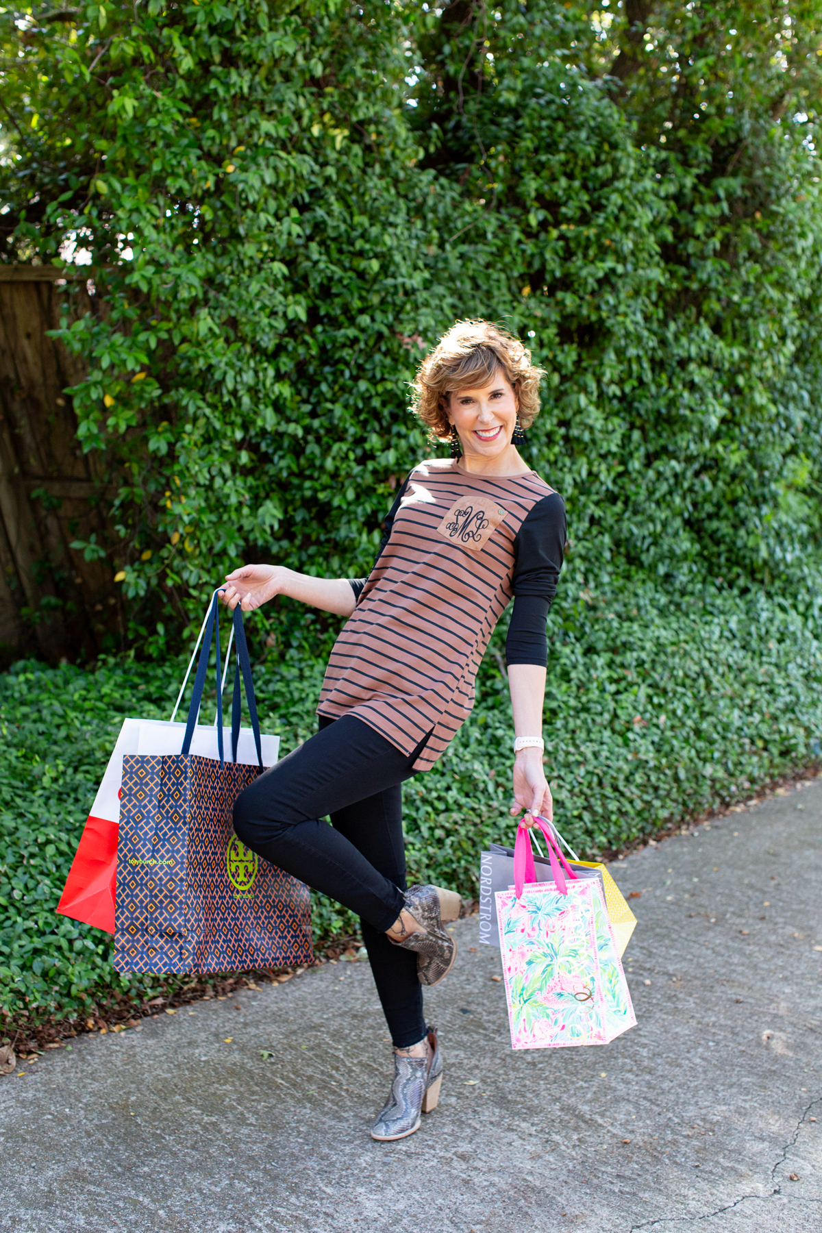 woman carrying multiple shopping bags