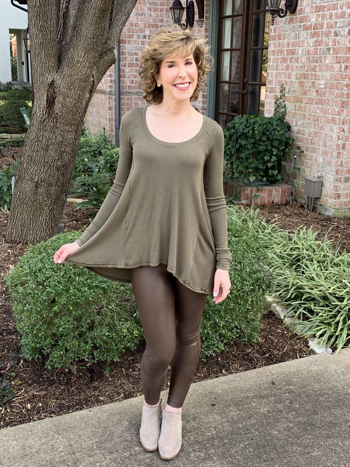 woman posing in green top in front yard