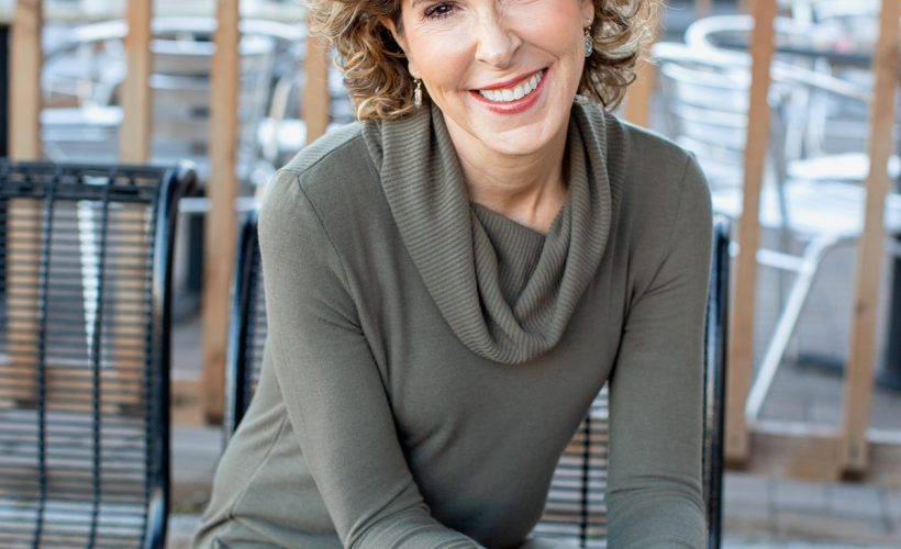 woman over fifty seated looking into camera
