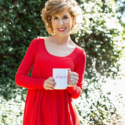 woman over 50 holding coffee cup that says blessed