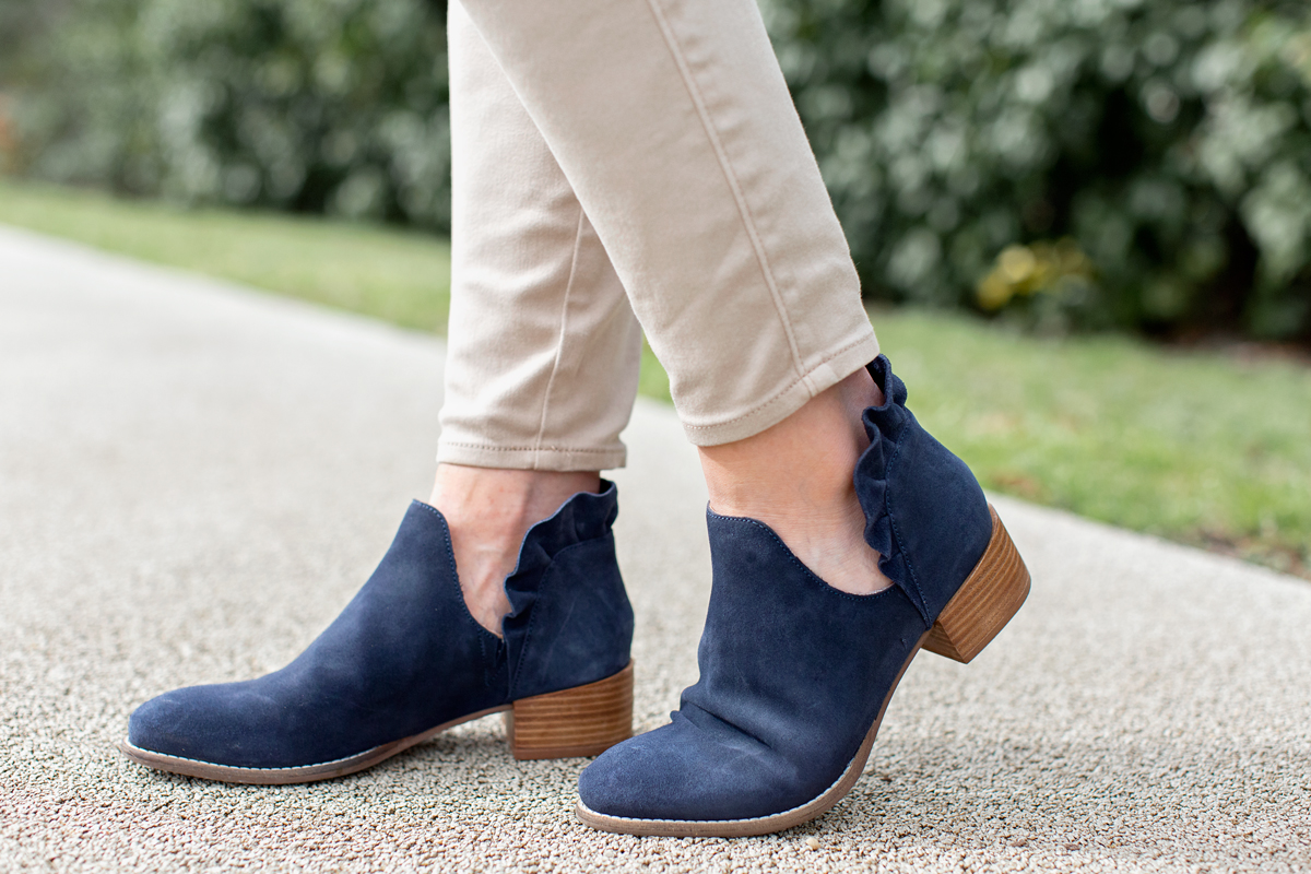 women's navy blue booties with ruffle on back