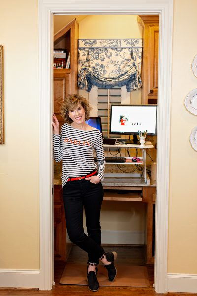 woman standing in doorway of small home office