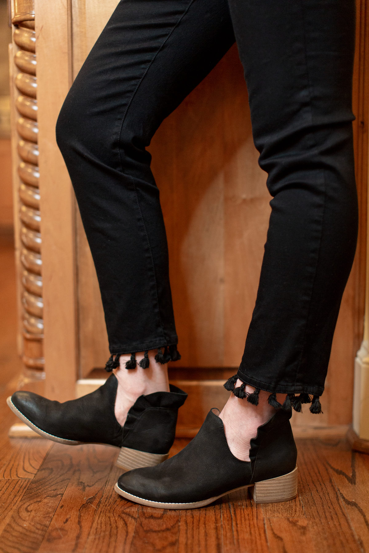 womens black tassel hem jeans with black ruffle back booties