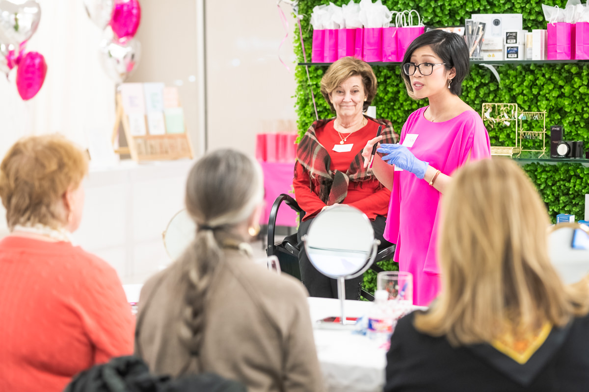 two women at the front of a makeup class
