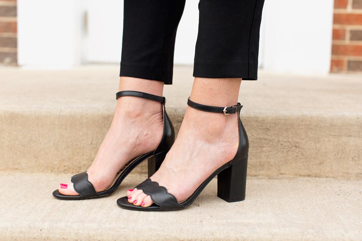 womens feet wearing black sam edelman odila sandals