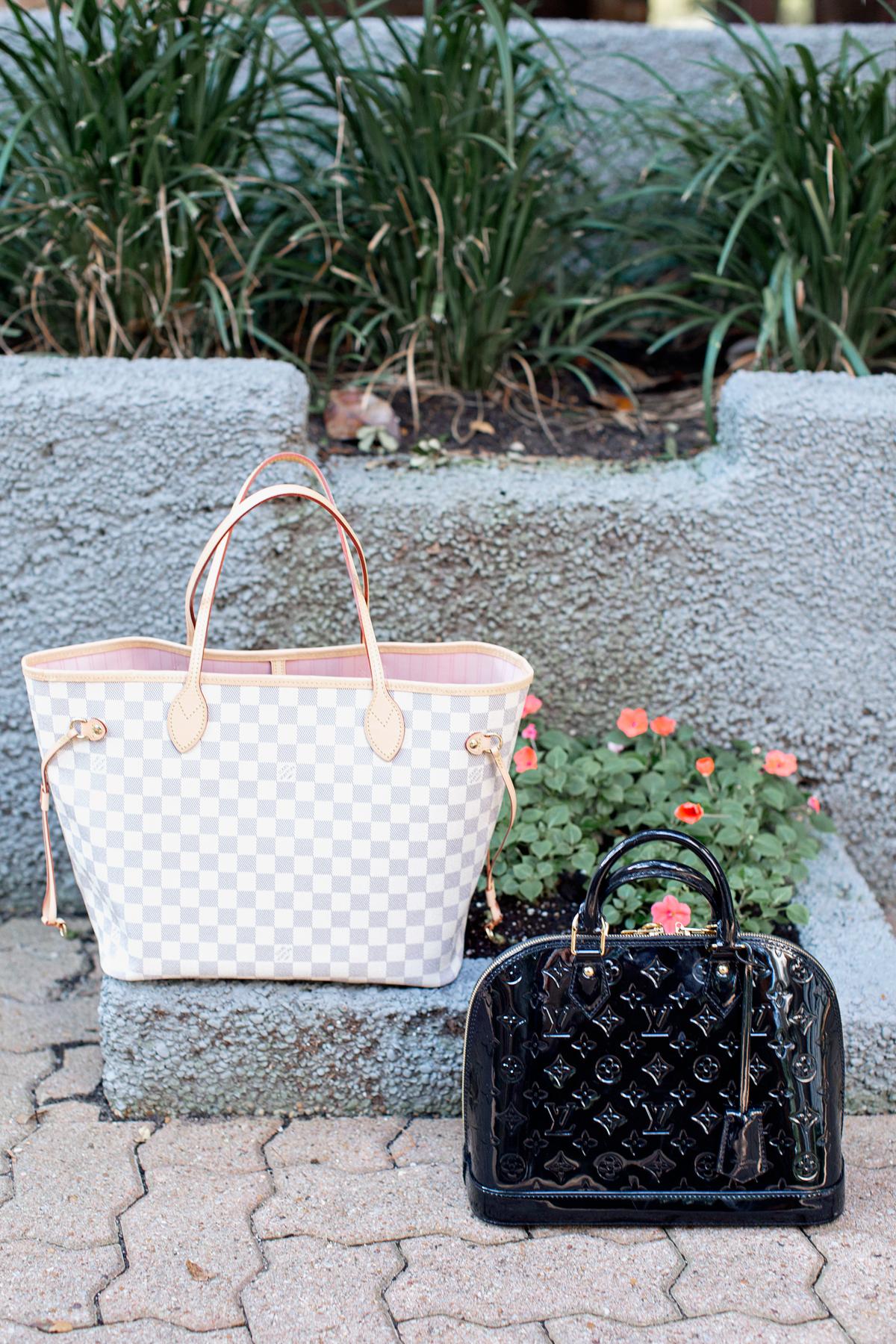 two designer handbags sitting on the ground