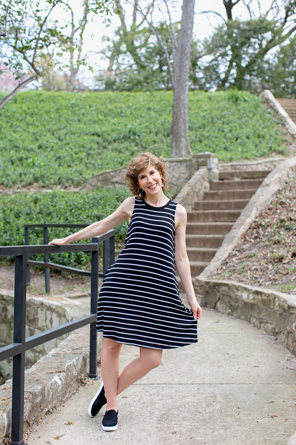 woman in black and white striped dress