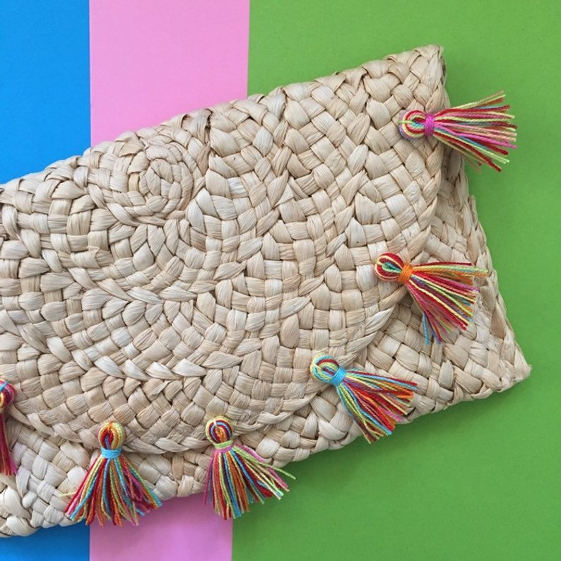 straw clutch handbag with multicolored tassels