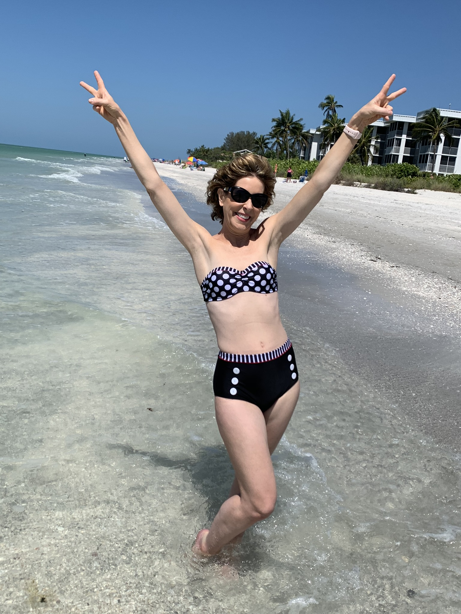 woman in two piece bathing suit on a beach