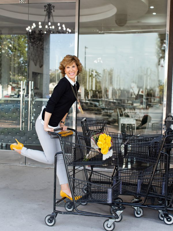 girl riding on a shopping cart