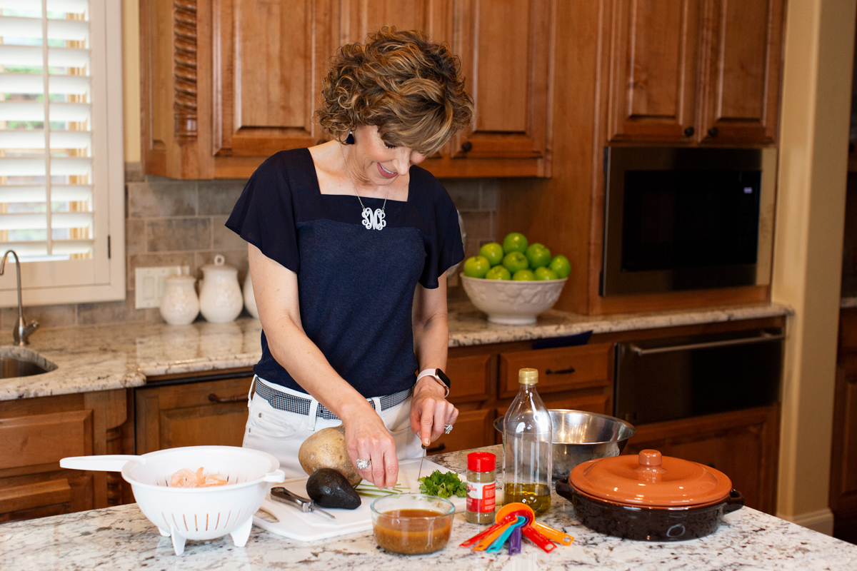 woman making southwestern shrimp recipe in kitchen