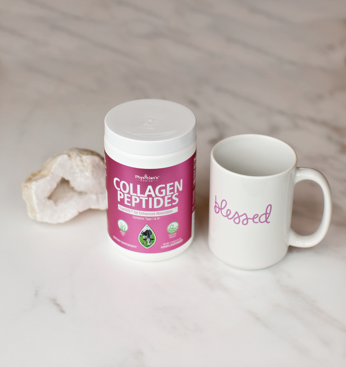 collagen powder and coffee mug on white marble background