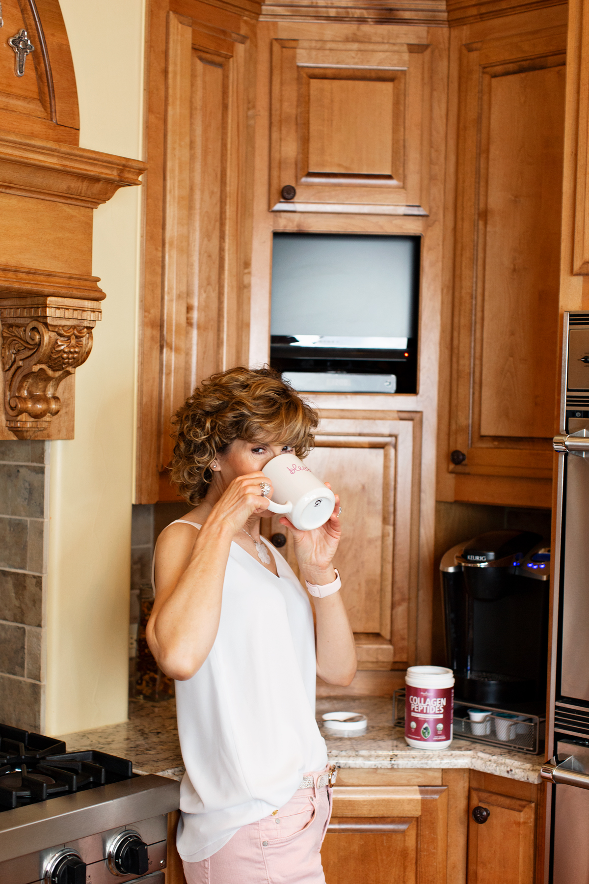 woman drinking coffee with collagen powder in it