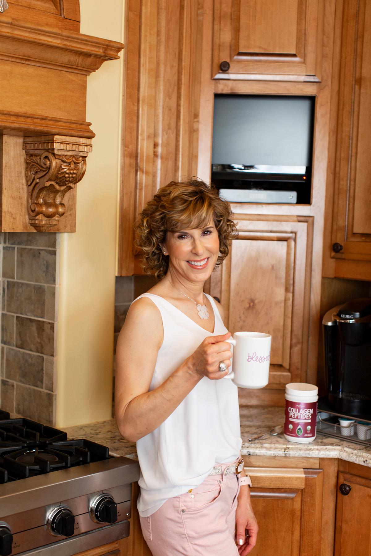 woman stirring collagen powder into her coffee
