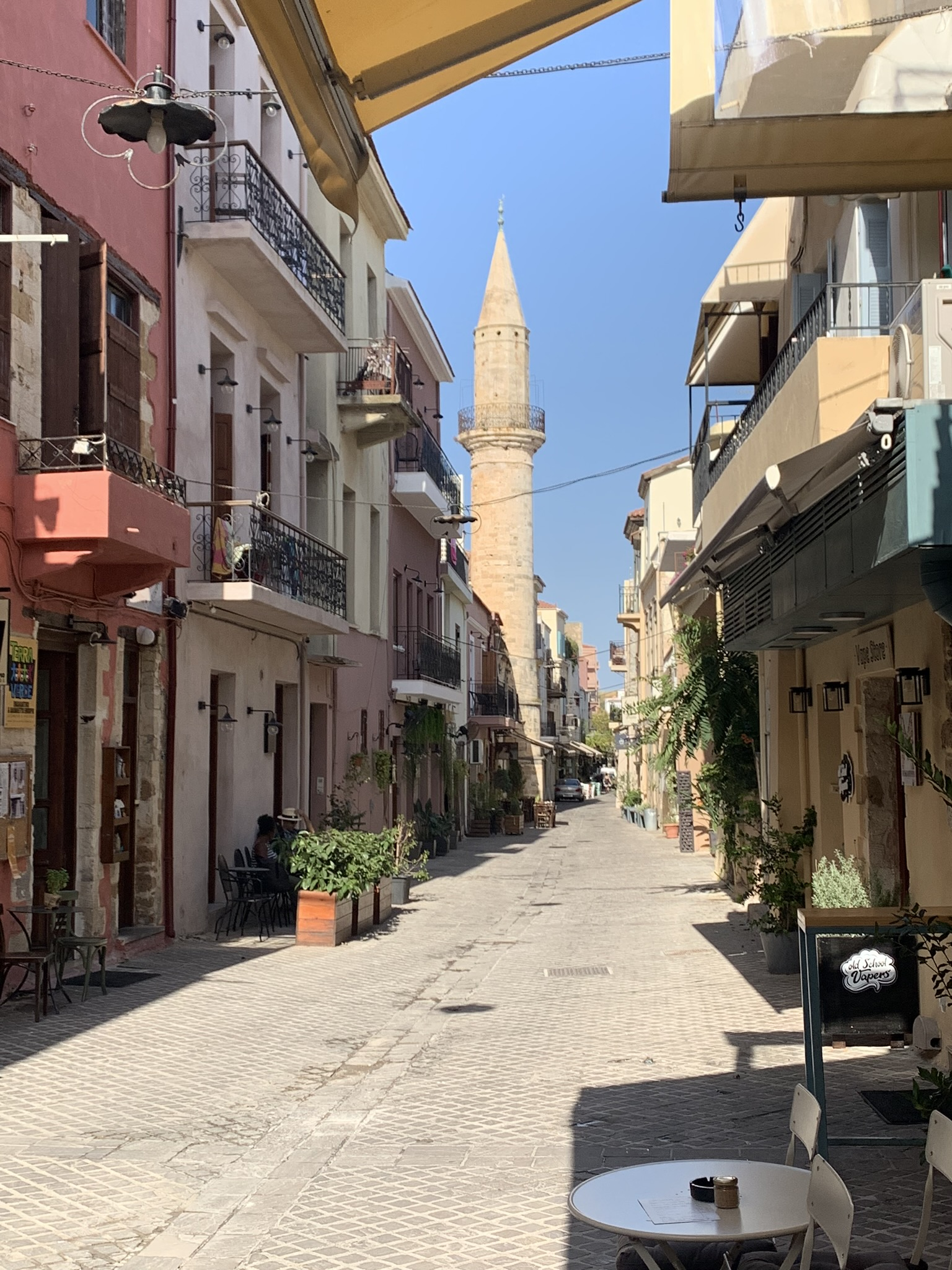 narrow street in the city of chania in crete greece