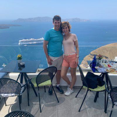 couple posing at a restaurant in santorini greece