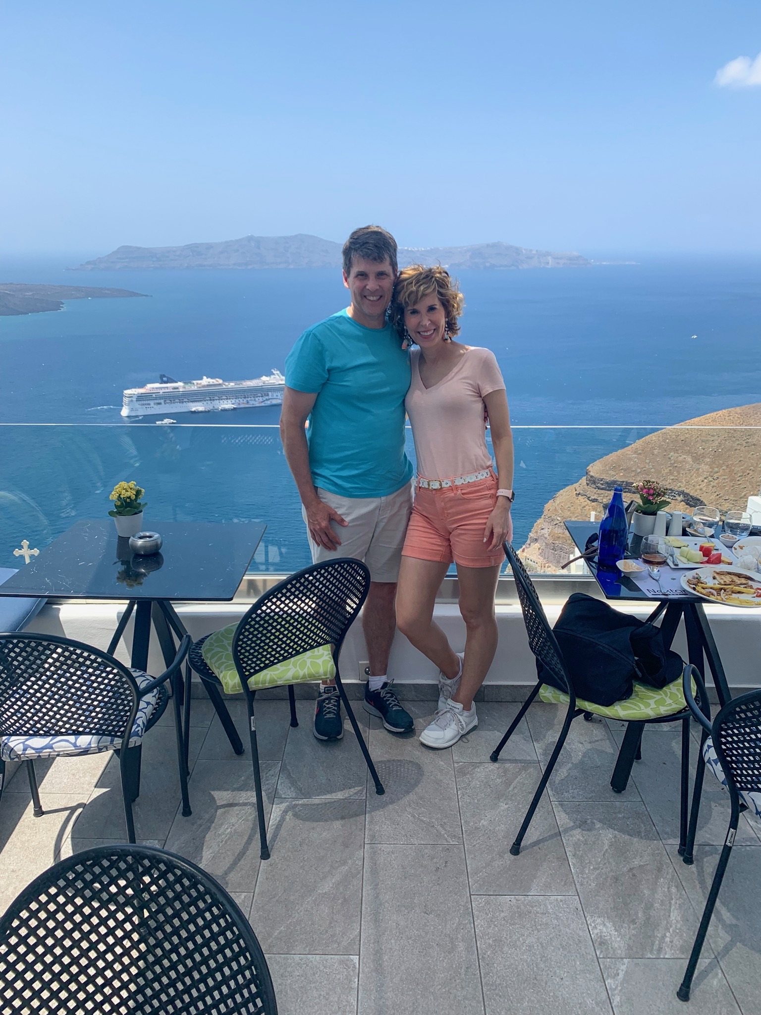 couple posing at a restaurant in santorini greece