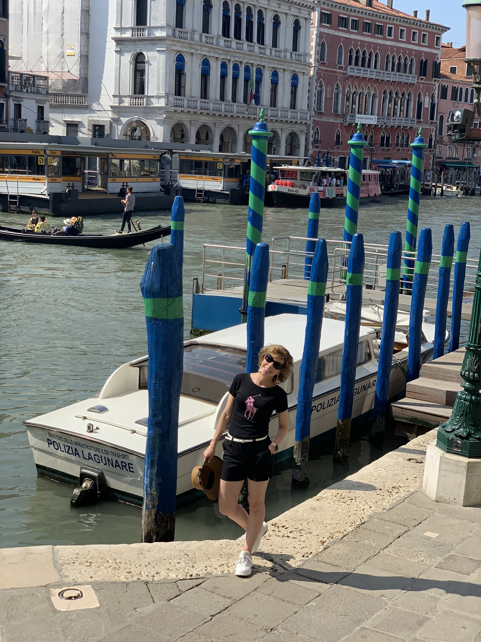 woman posing by canals in venice greece