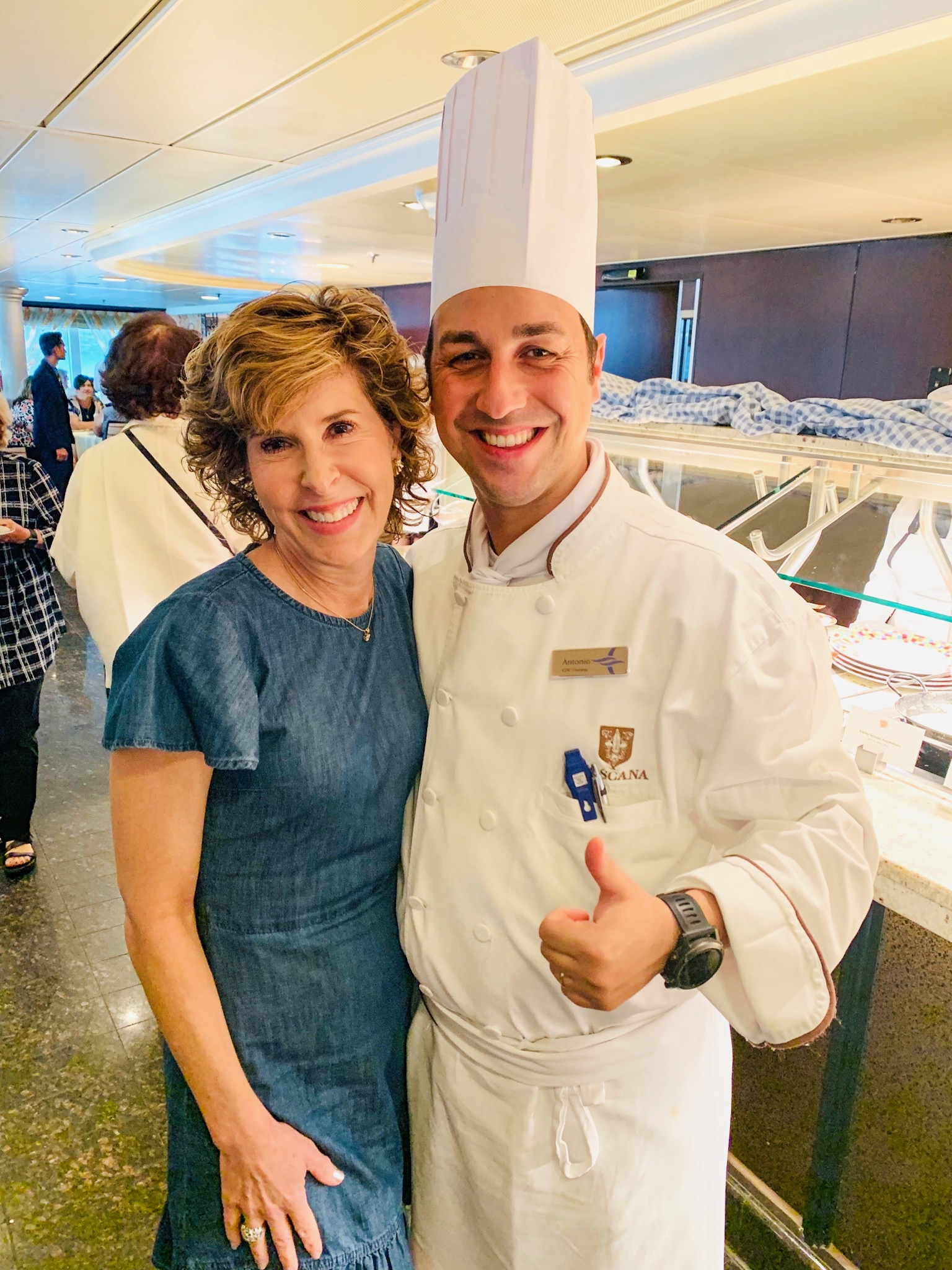 woman posing with a chef