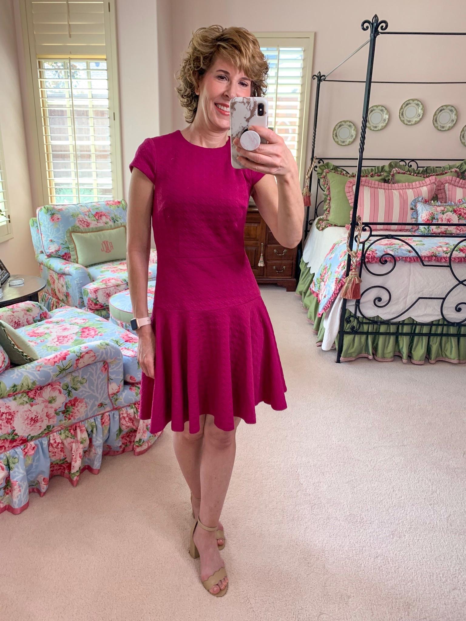 mirror selfie of woman in pink dress