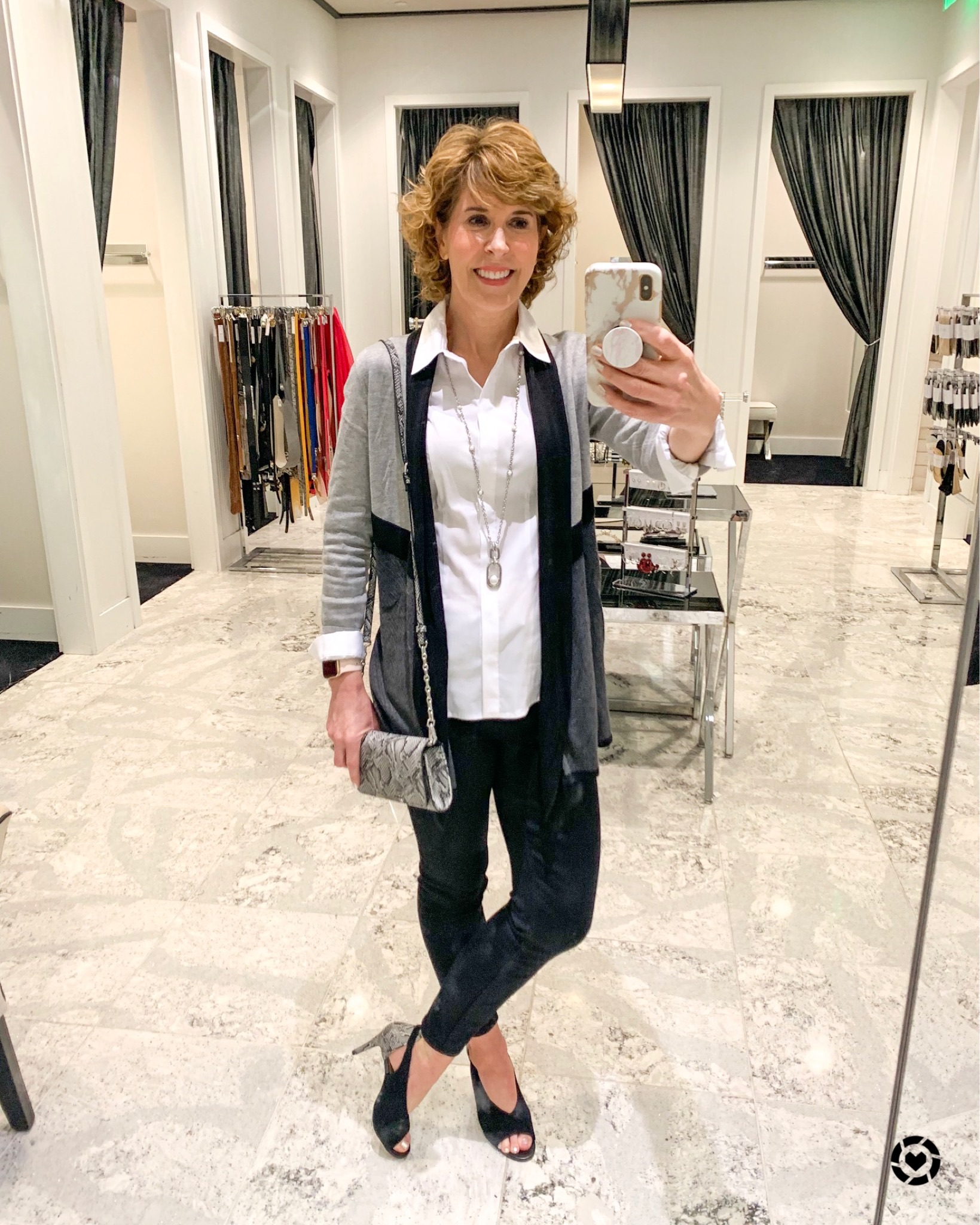 mirror selfie of woman in gray cardigan