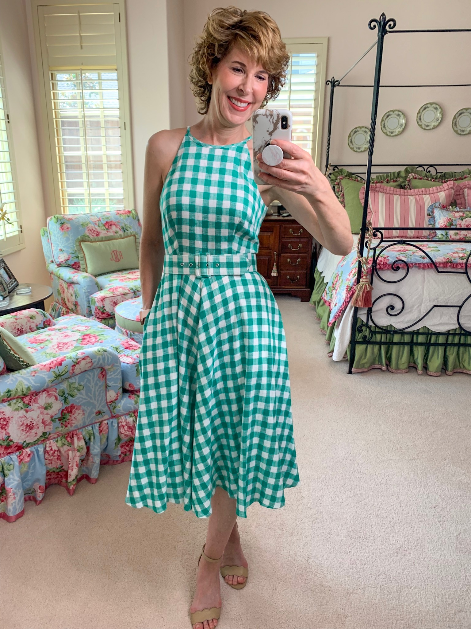 mirror selfie of woman in green and white gingham dress