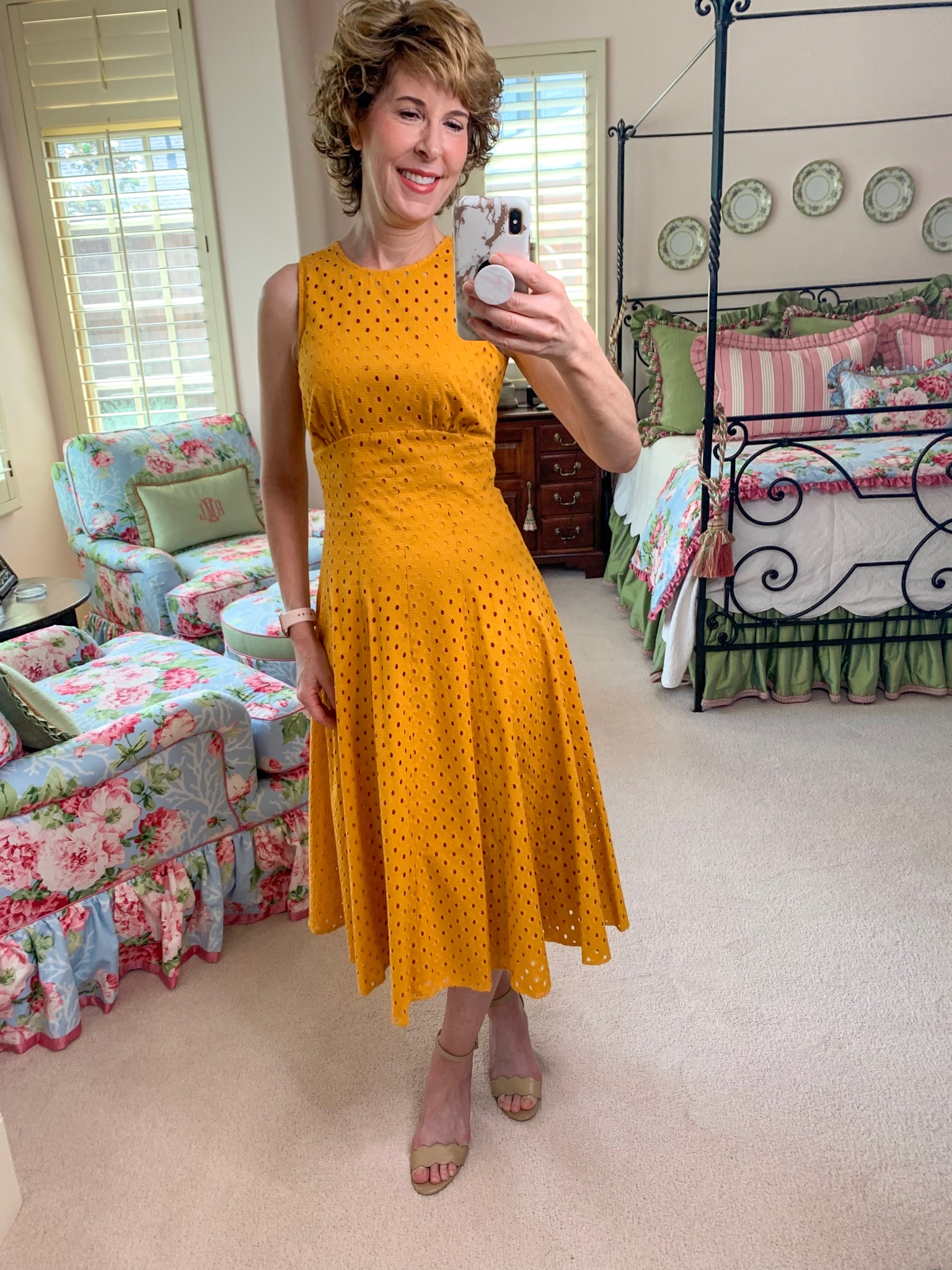 mirror selfie of woman in gold eyelet dress