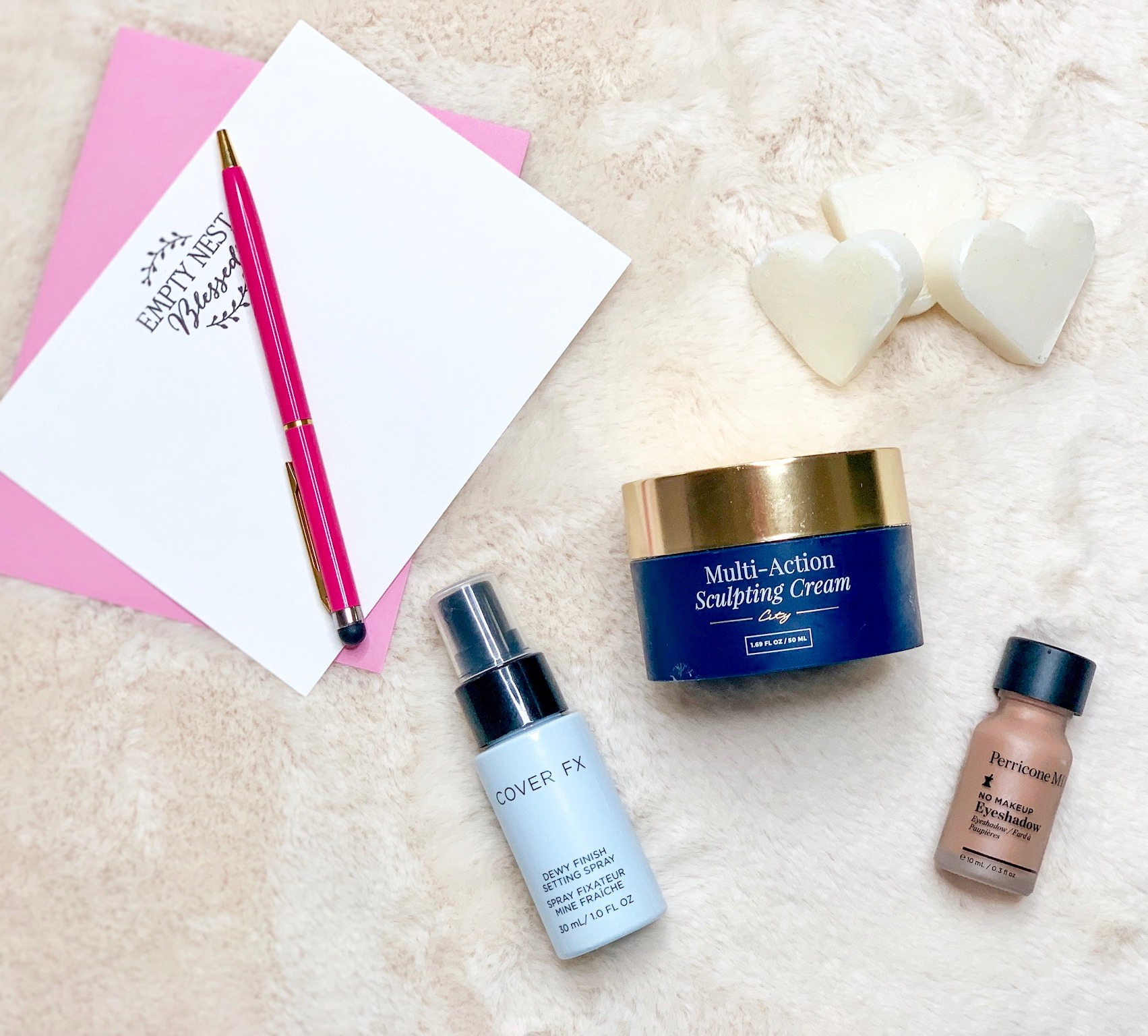 three beauty products, heart soap, and empty nest blessed stationery