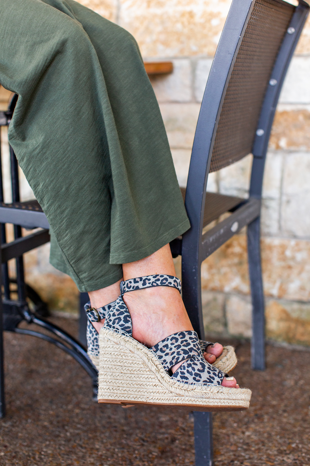 animal print wedges on a woman