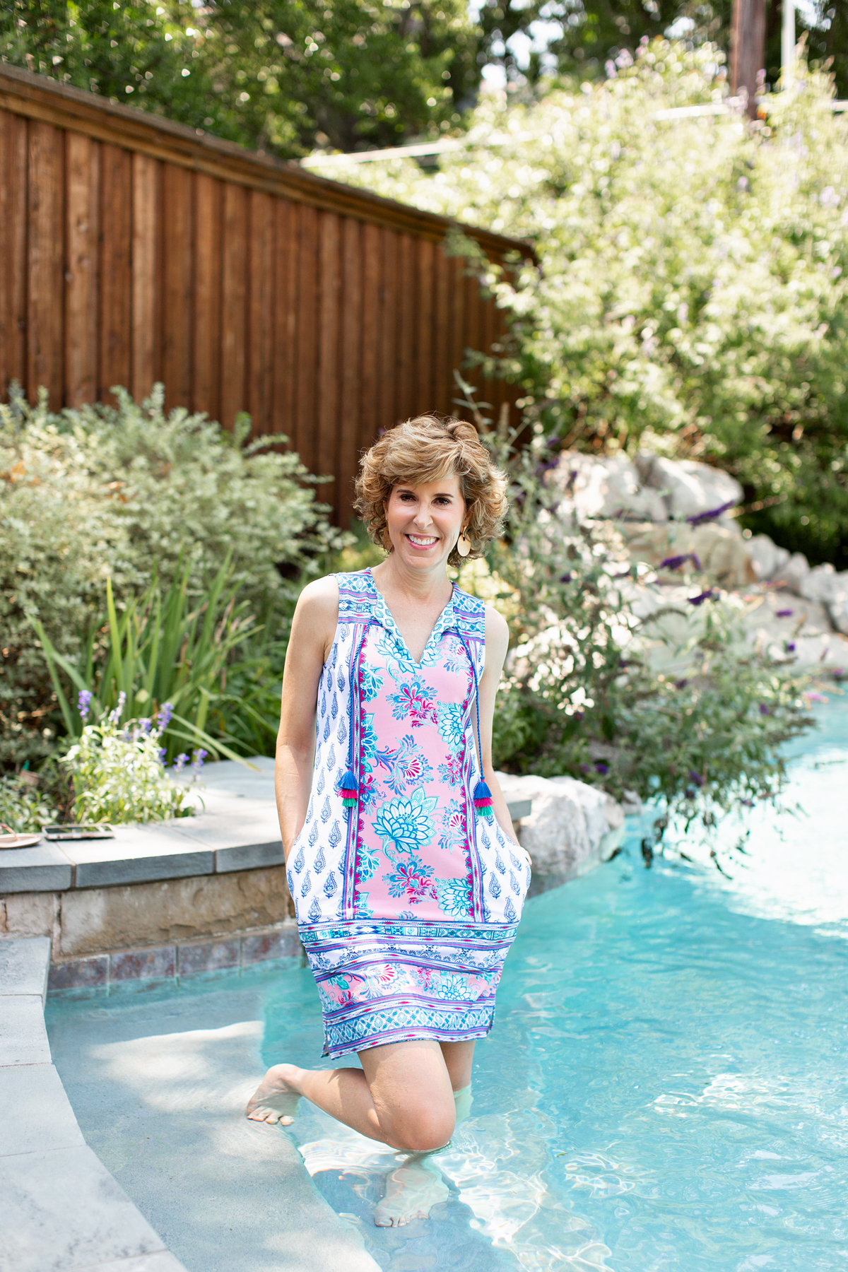 woman in cabana life dress standing in the pool