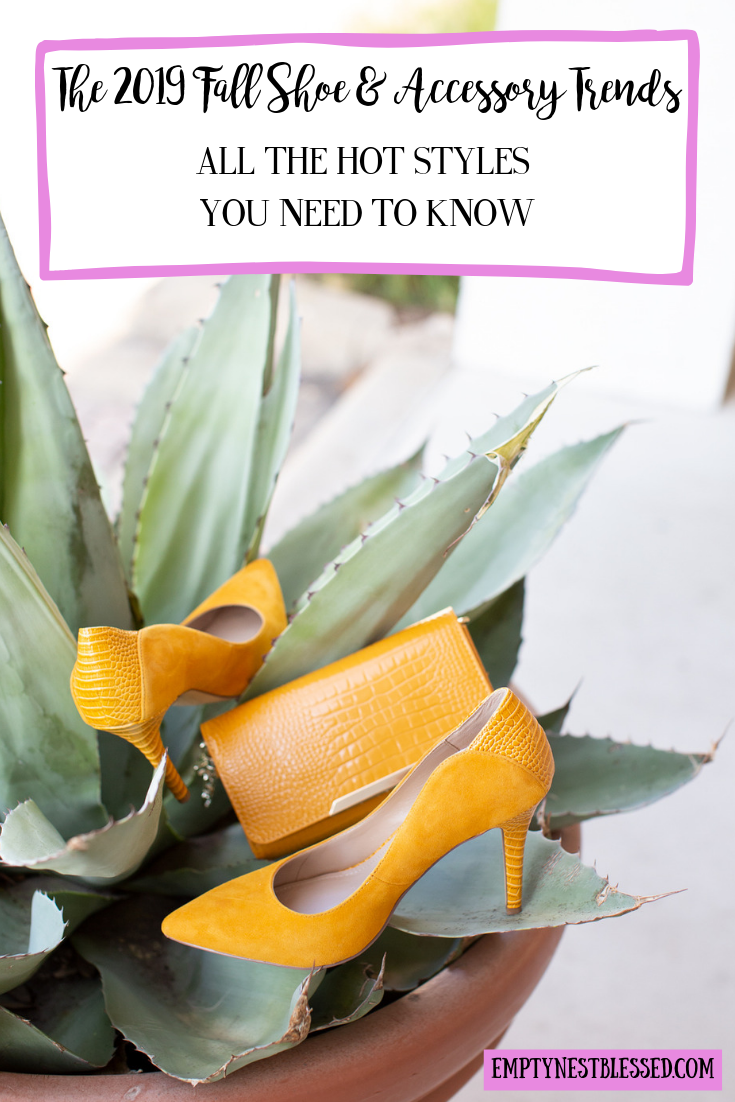 yellow pumps and handbag sitting among the leaves of a plant as an example of 2019 fall shoe & accessory trends