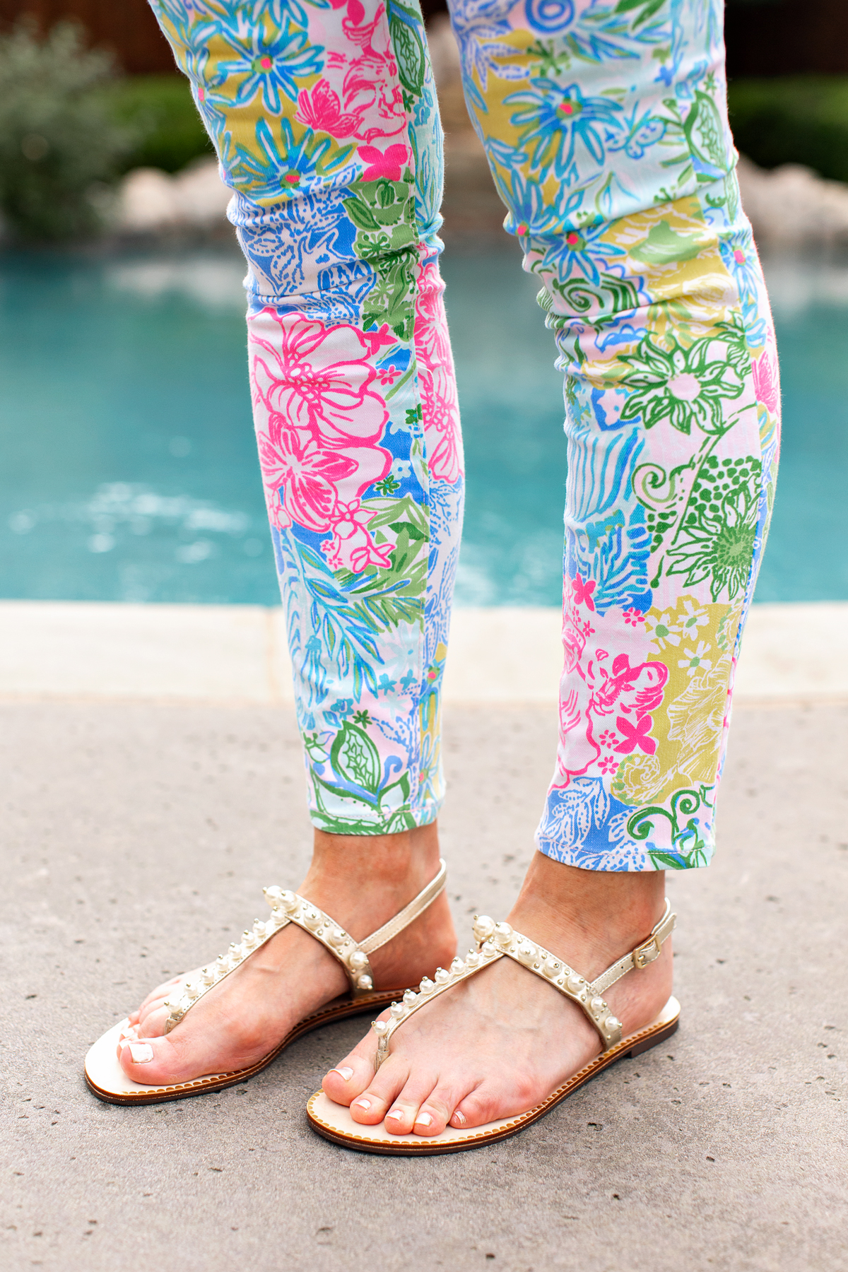 woman's legs and feet standing next to pool wearing lilly pulitzer