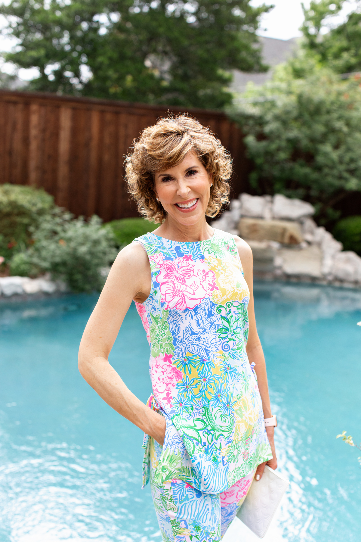woman standing next to pool wearing lilly pulitzer tunic