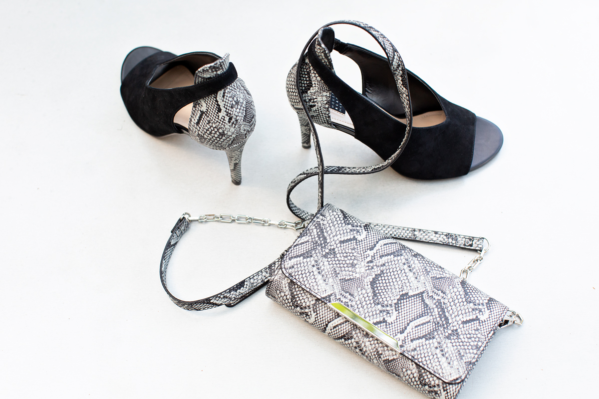 black peep toe pumps with snake detailing and snake clutch or crossbody purse