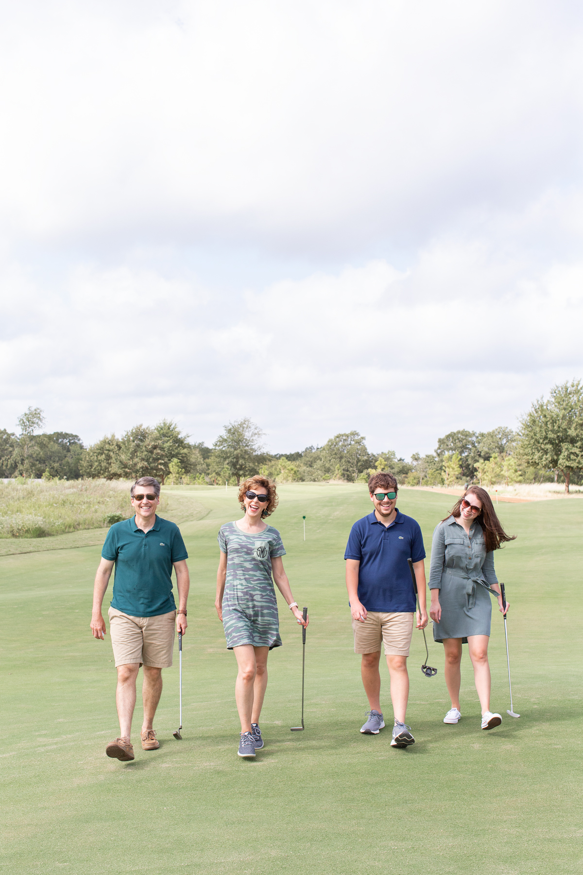 two couples walking together on a golf course