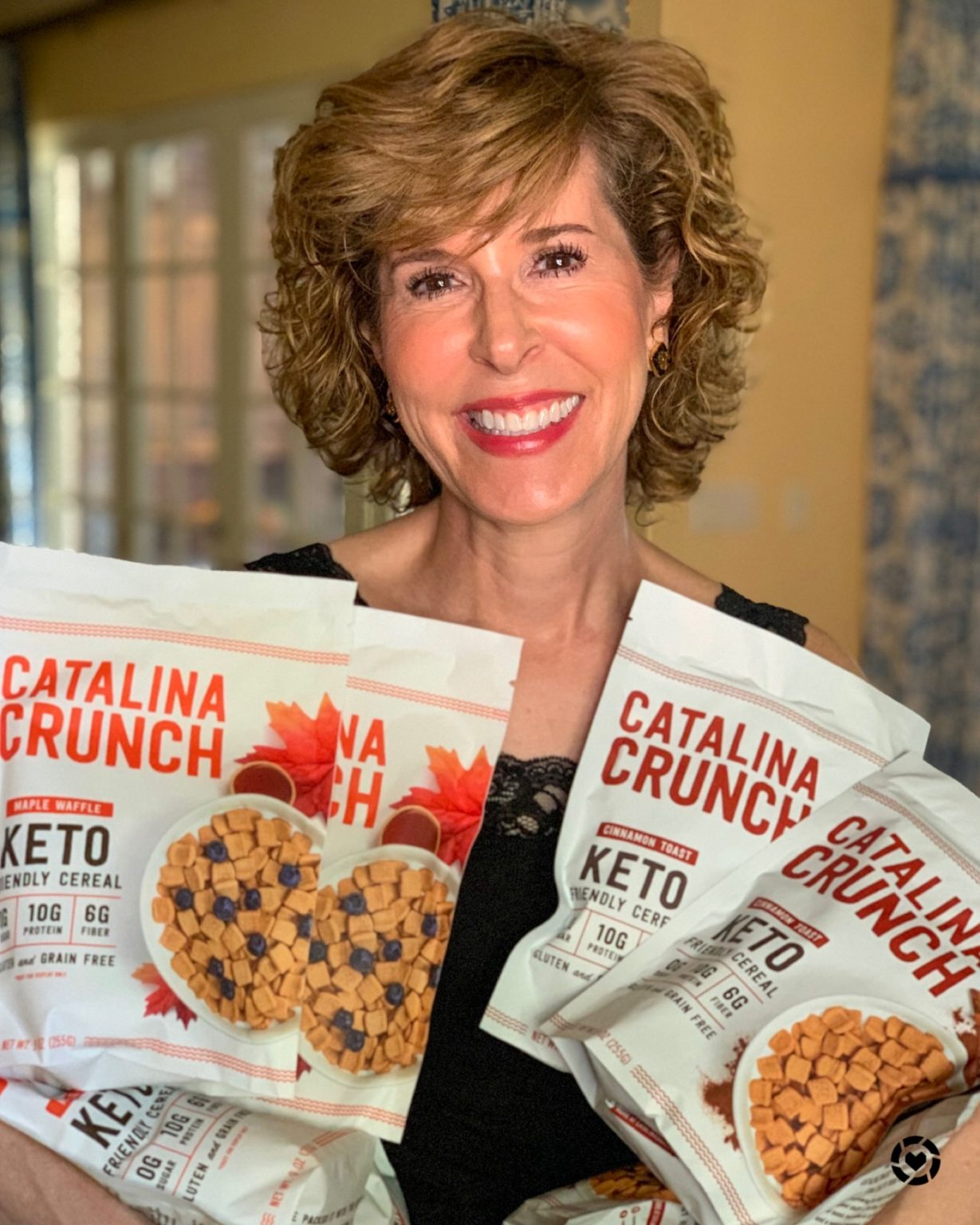 woman holding armfuls of catalina crunch cereal