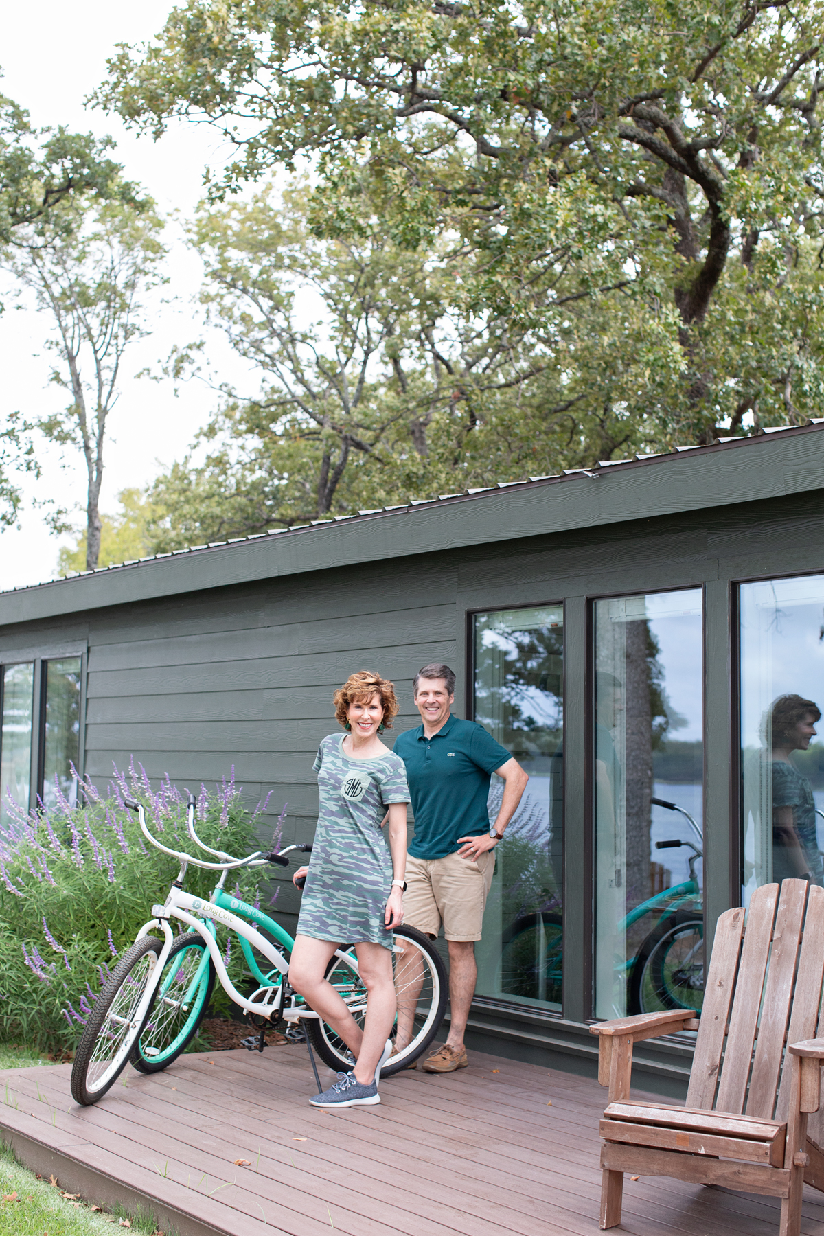 man and woman standing on a porch next to two bikes