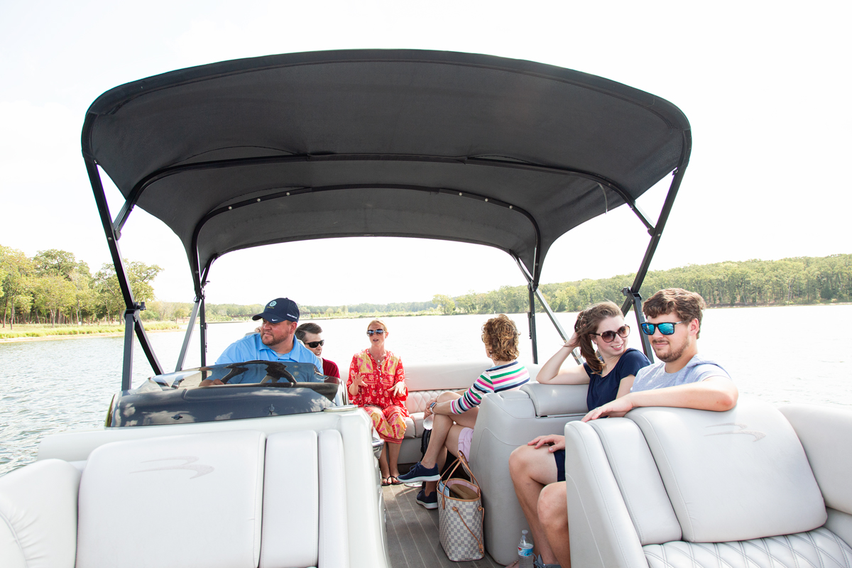 six adults on a boat ride at long cover