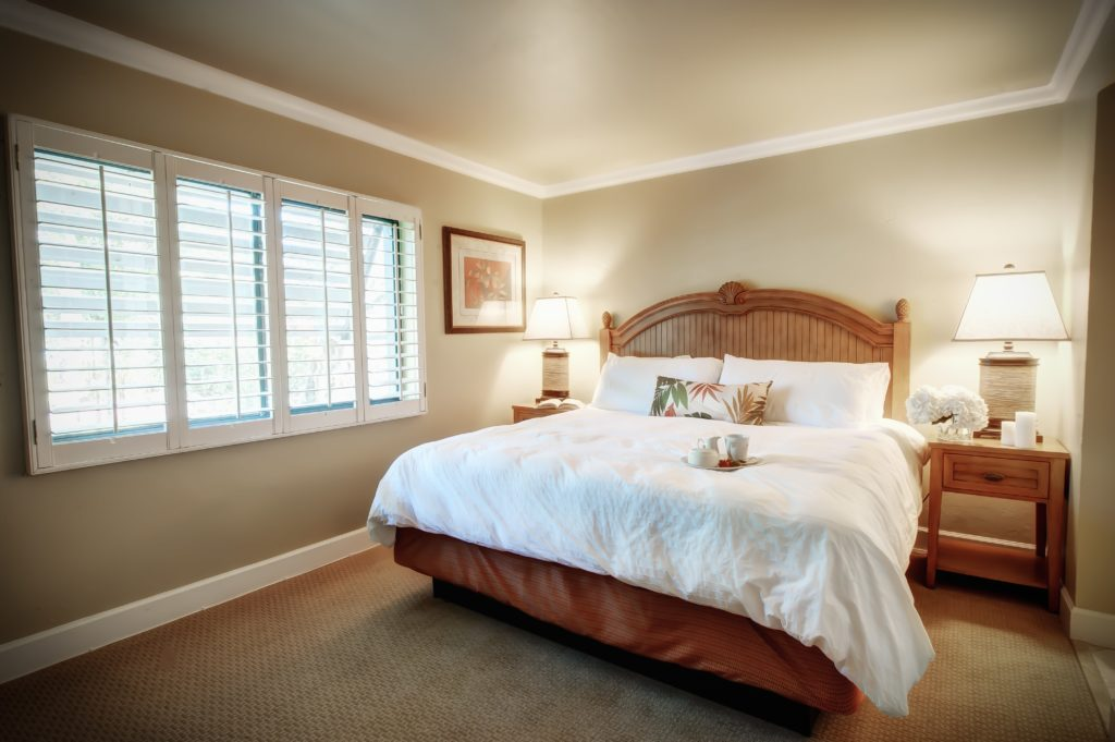 king bed in bedroom of beachfront condo