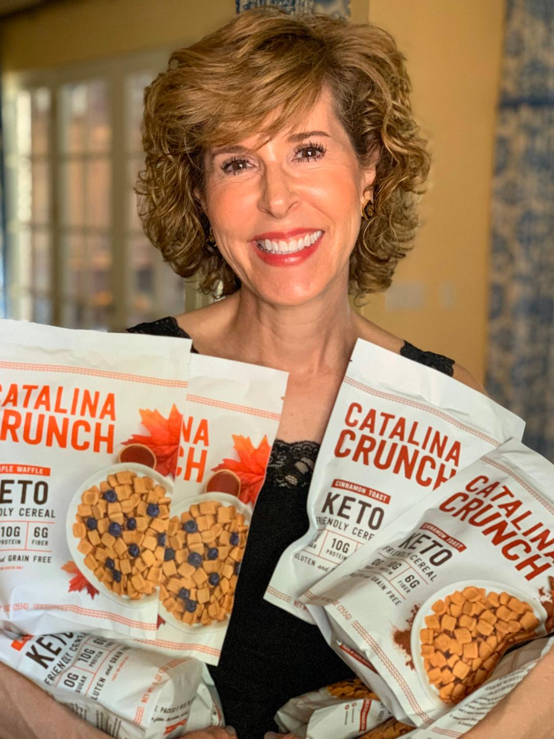 woman holding bags of catalina crunch cereal