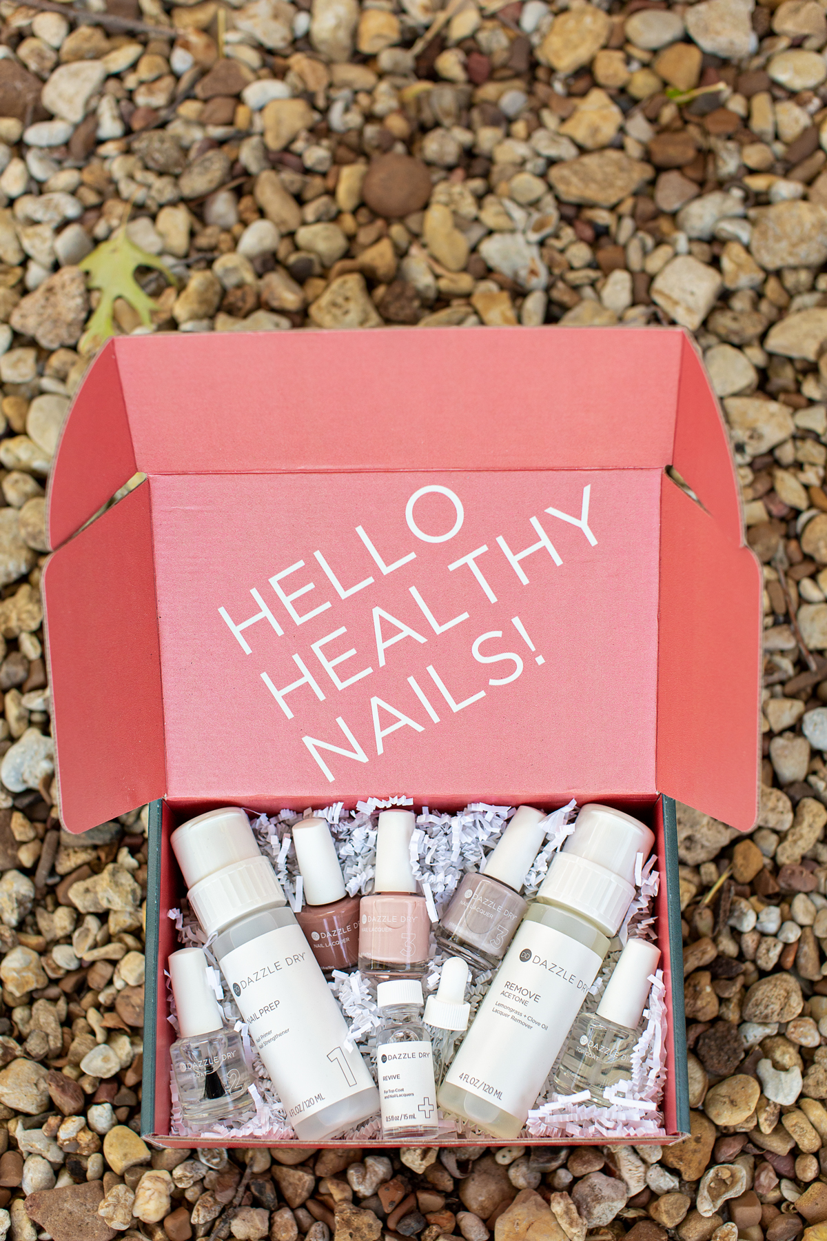 dazzle dry nail products in a box