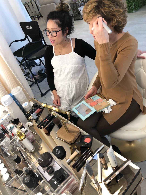 woman applying makeup during a makeup lesson