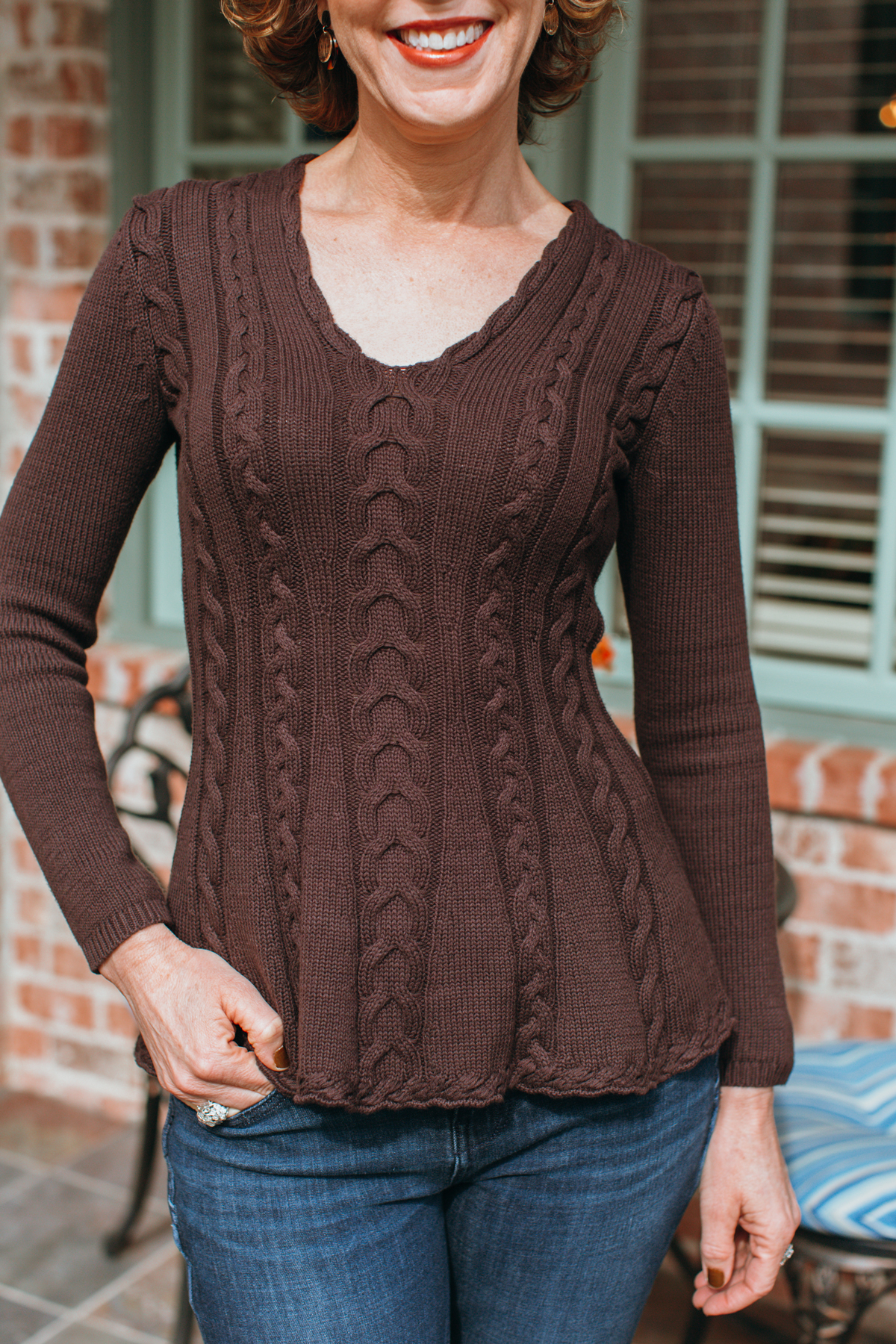 close up of a brown a line sweater