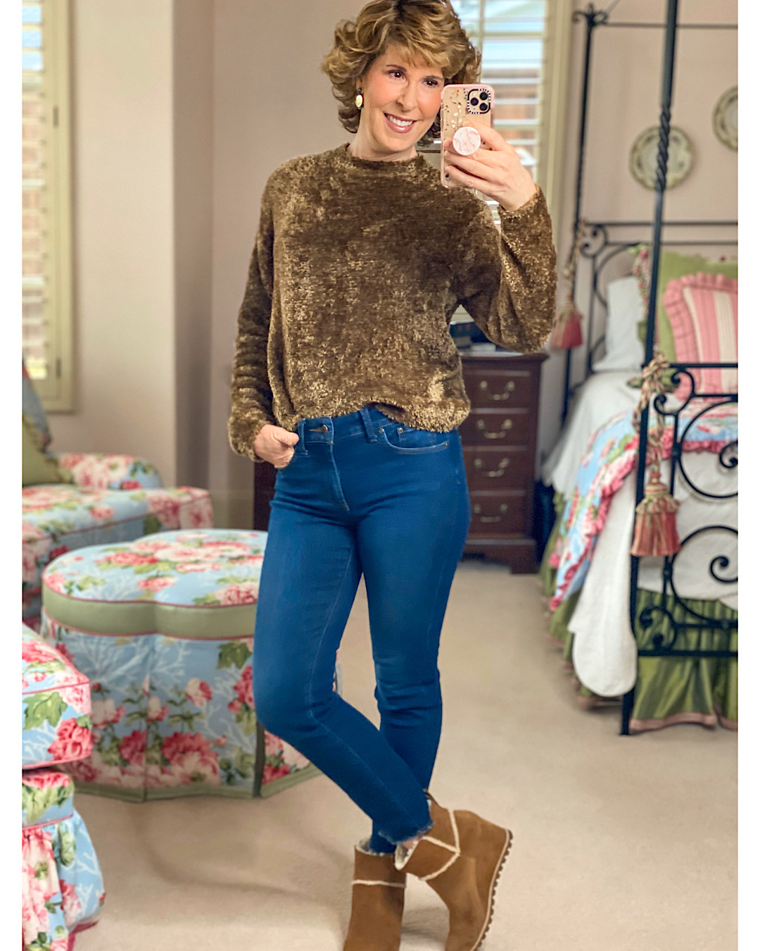 mirror selfie of woman in brown fuzzy sweater