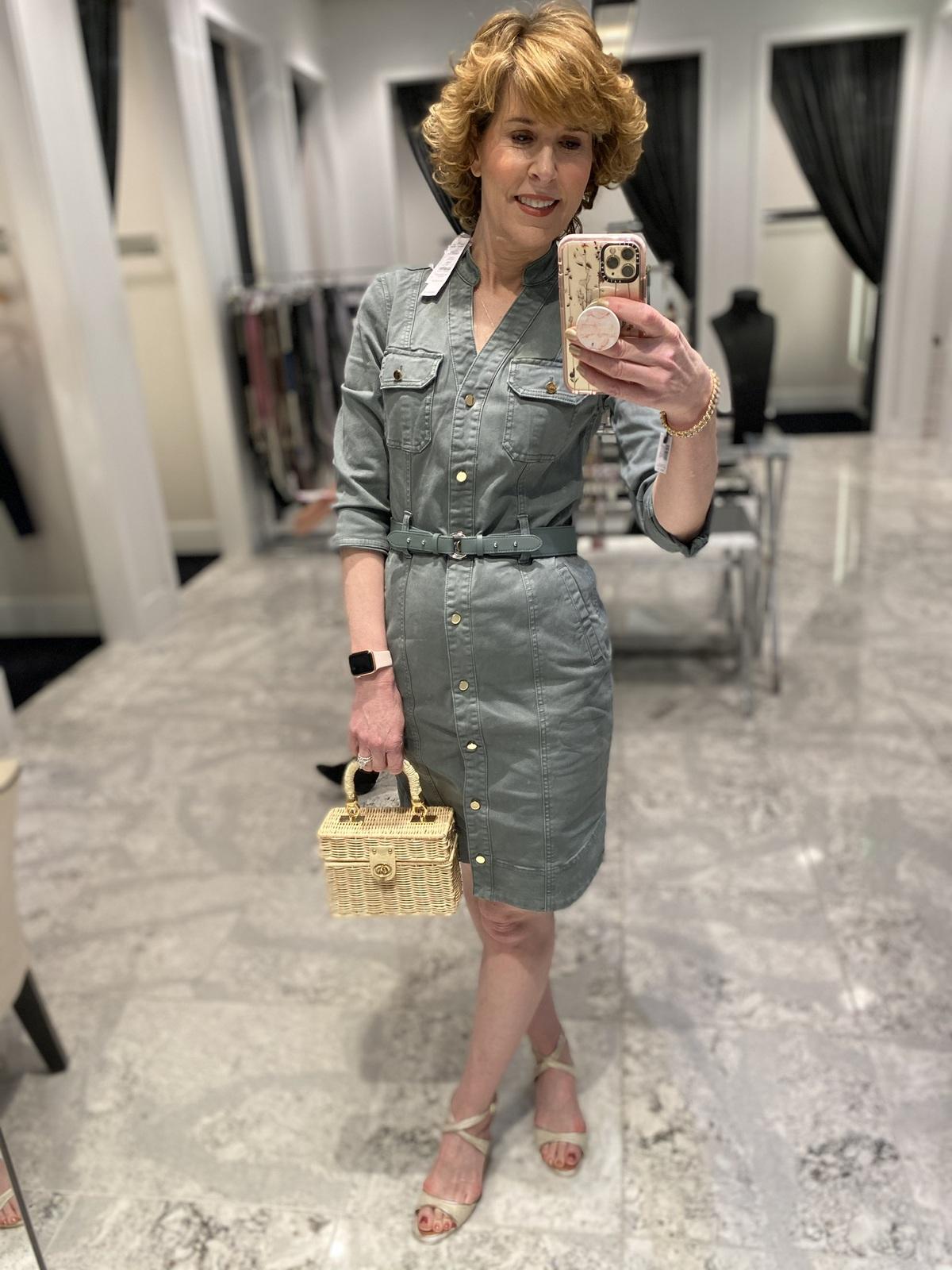 Mirror selfie of woman over 50 wearing green shirtdress green laser cut booties carrying wicker handbag doing spring wardrobe update
