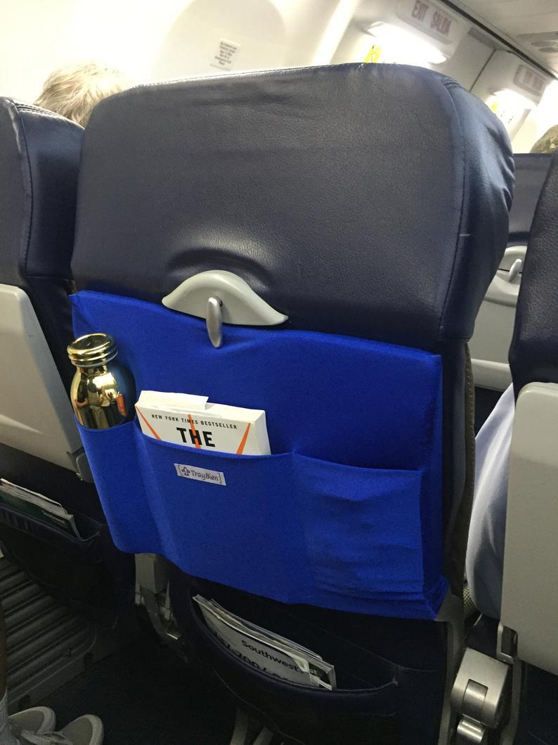 fly caddy attaches to back of airplane tray table